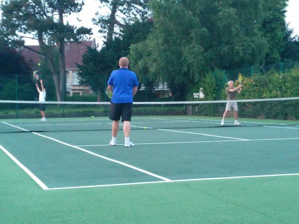 League tennis match in progress